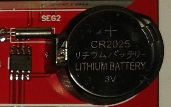 часовой кварц и батарейка.